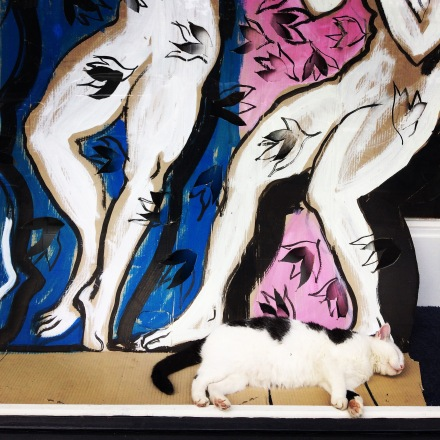 This artsy cat blending in with its artwork